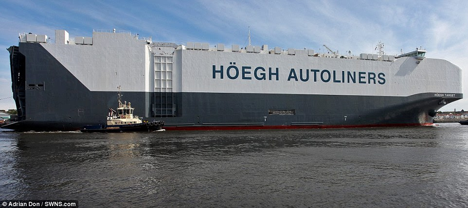 The Norwegian-registered Hoegh Target, which can carry 8,500 vehicles and boasts a deck the size of 10 football pitches, has arrived into the UK on its maiden voyage from China. It has a deck space of 71,400 square metres, made up for 14 decks including five 'liftable' decks