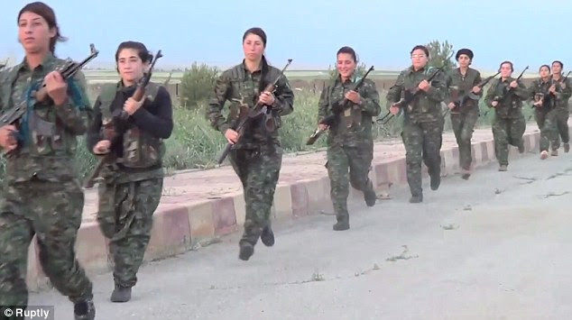 http://i.dailymail.co.uk/i/pix/2014/10/22/1413981456632_wps_66_FEMALE_KURDISH_SOLDIERS_B.jpg