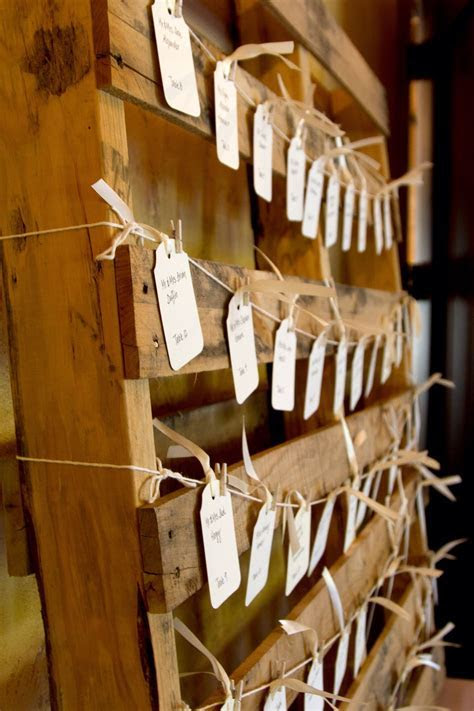 Our place cards for tables. Recycled wooden pallet, string
