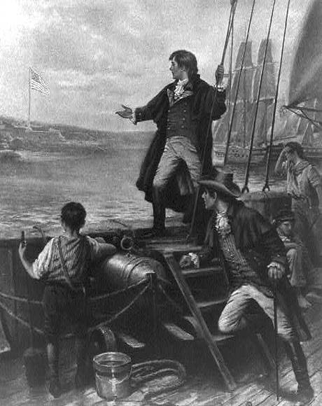 Francis Scott Key standing on boat, with right arm stretched out toward the United States flag flying over Fort McHenry, Baltimore, Maryland.