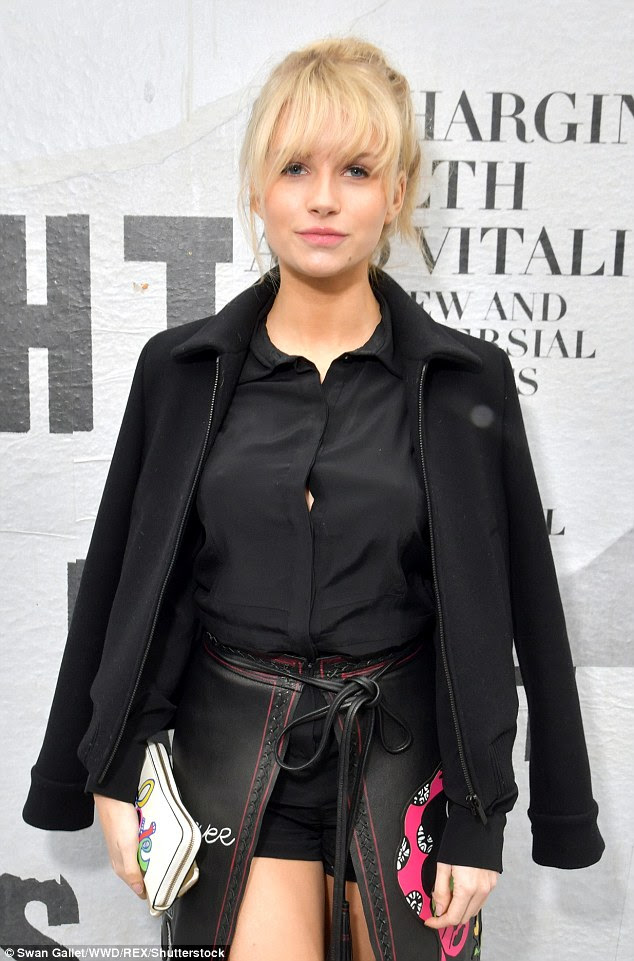 Model beauty: Lottie's eye-catching skirt was teamed with a simple black tailored blouse, with matching shorts underneath to ensure nothing gets exposed in the wrap opening