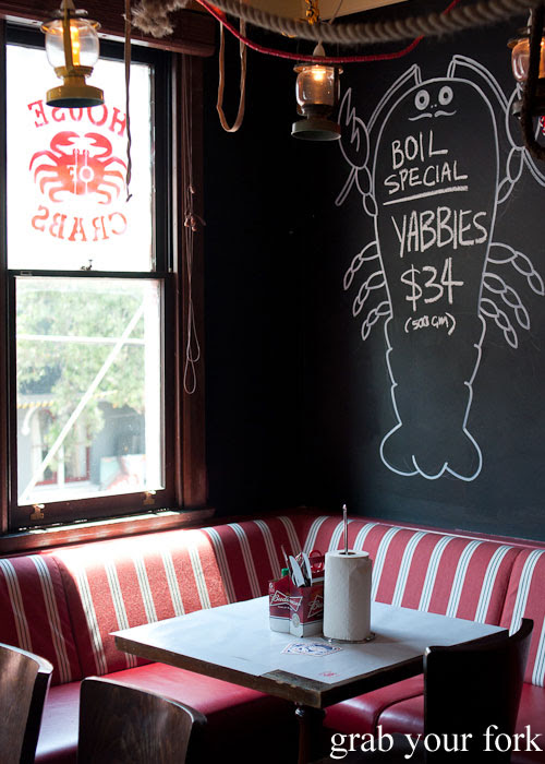 Booth seating and blackboard menus at House of Crabs, Norfolk Hotel, Redfern