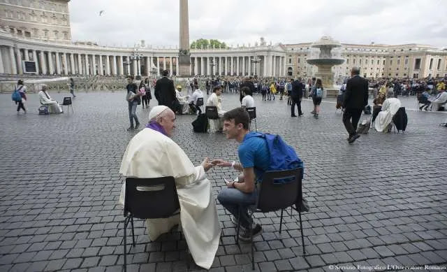 Pope Francis hears confessions of teenagers in St. Peter's Square. Credit: L'Osservatore Romano.