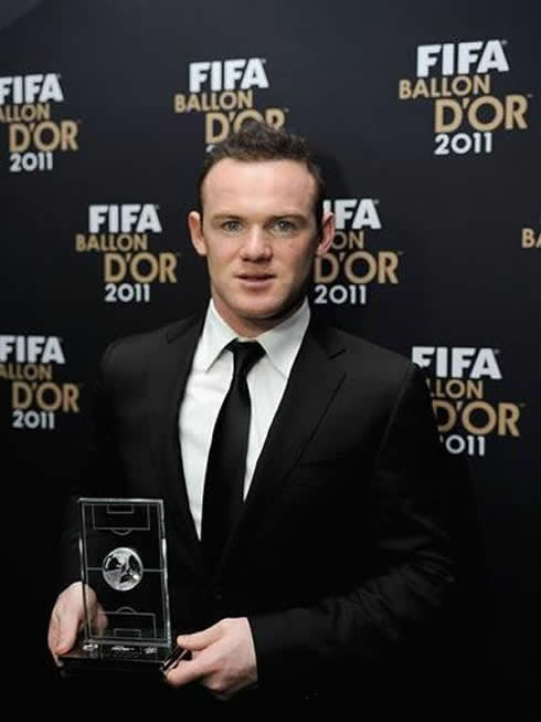 Wayne Rooney new grown hair, holding his award at the FIFA Balon d'Or 2011