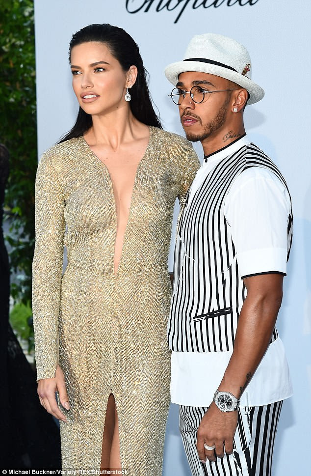 Model moments: Lewis pouted as he posed with supermodel Adriana Lima