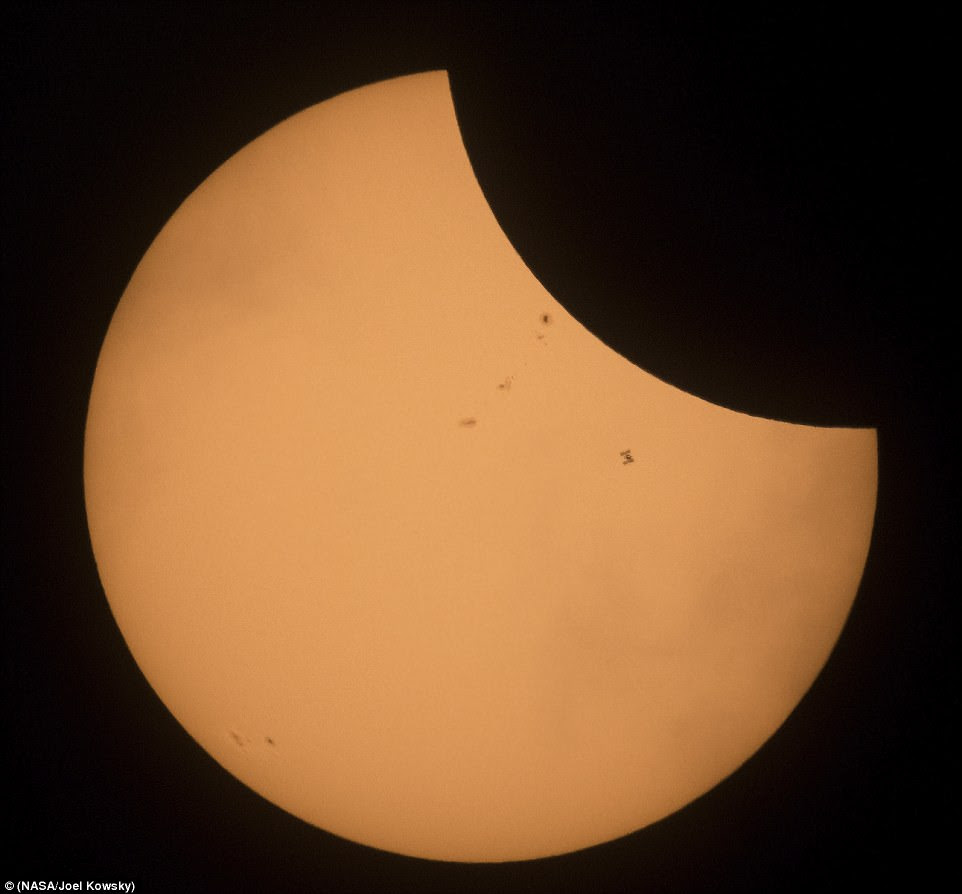 The International Space Station can clearly be seen in front of the sun, and moon, in this stunning image