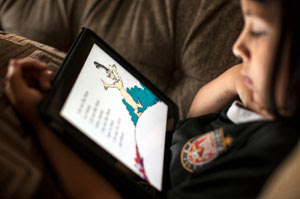 Child reading on a tablet computer