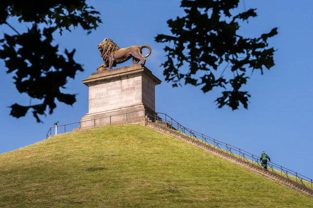 In this June 9, 2015, file photo, a visitor walks to the top of the Lion's Mound in Braine-l'Alleud, near Waterloo, Belgium. On Wednesday, June 17, 2015, fou...