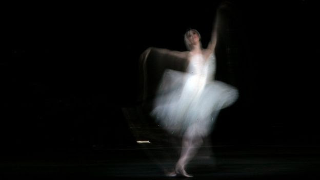 A dancer from The Royal Ballet performs during a dress rehearsal for Swan Lake