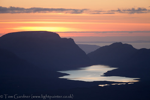 Sunset over Lochan Fada and Slioch from the top of Fionn Bheinn by tomgardner