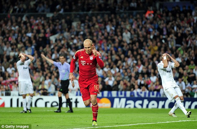 Making his point: Robben celebrates scoring from the penalty spot and hauling Bayern level on aggregate