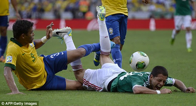Upended: Javier Hernandez goes down under a challenge from Thiago Silva