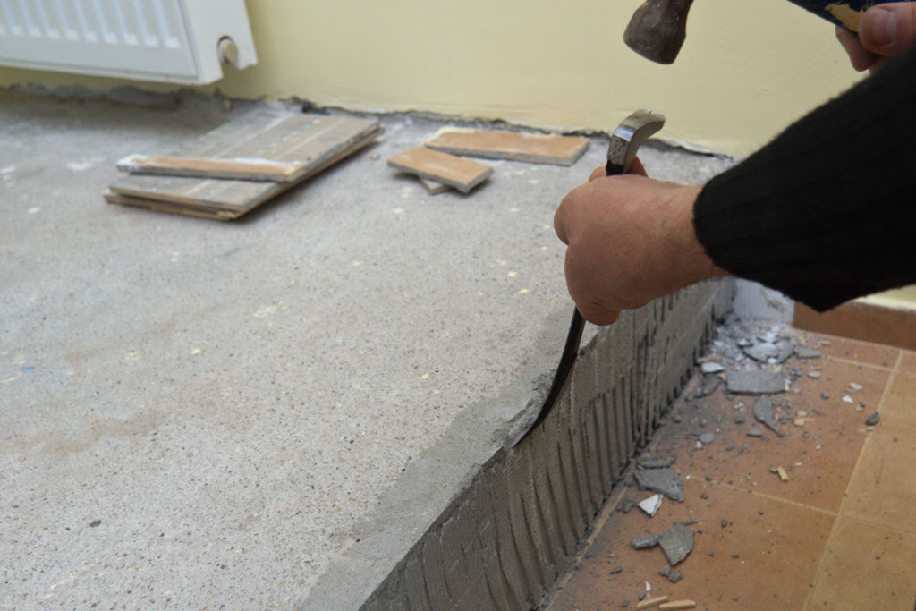 removing asbestos tile from cement floor