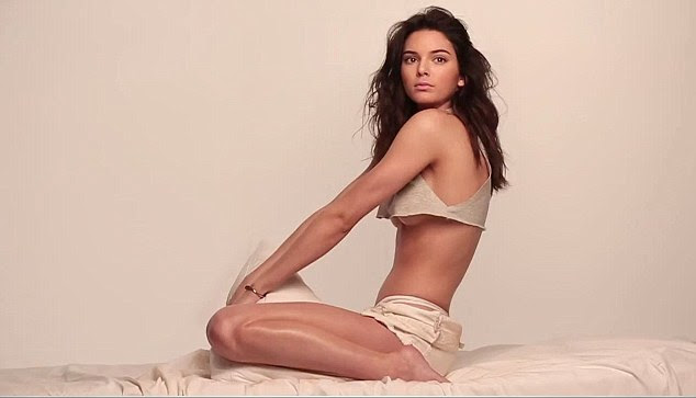 Daring to bare: Kendall confidently shows off her lean and slender frame to perfection while posing seductively on some sheets