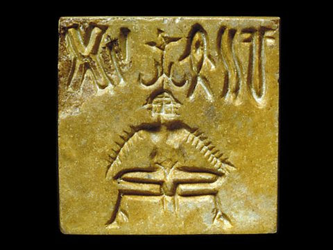 An Indus seal with a three-headed figure