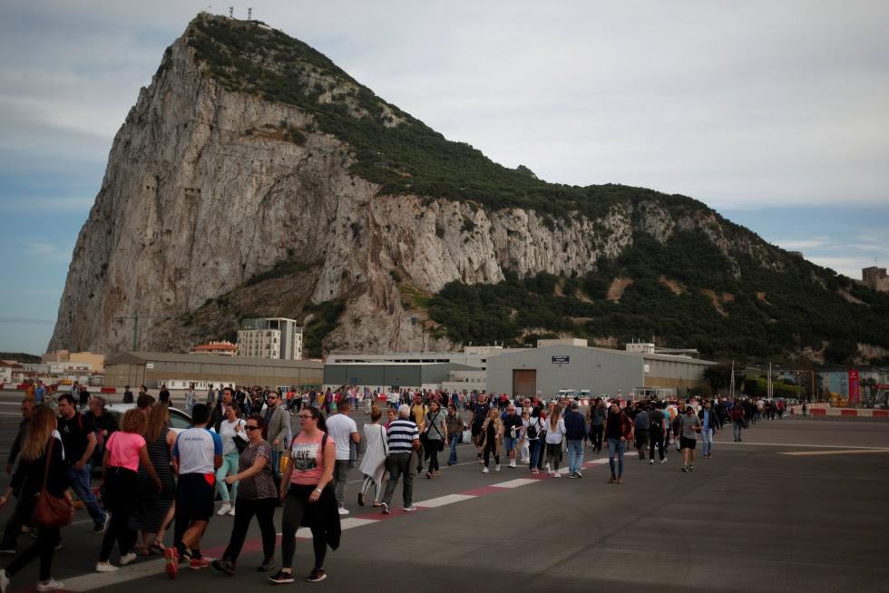 Pedestrians cross the runway at Gibraltar airport.