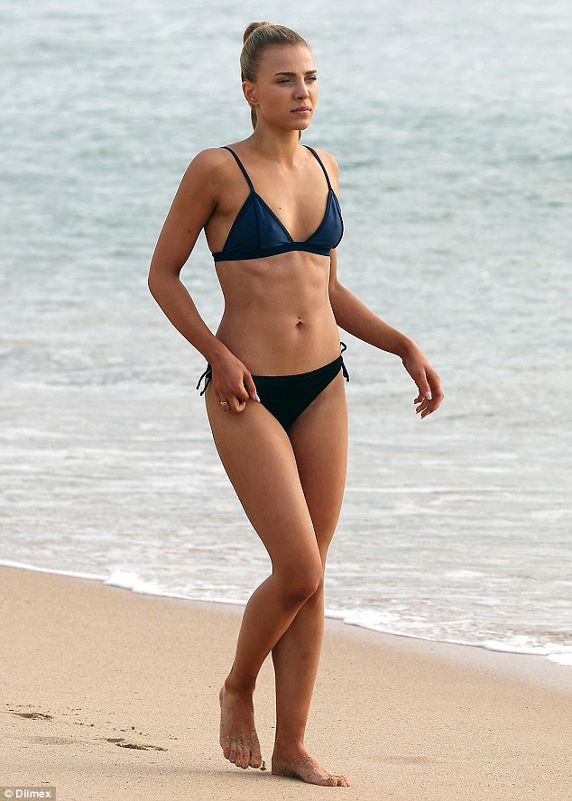 Flaunting it: The Bachelor's Olena Khamula showcased her washboard abs and slender frame in a revealing two-piece bikini as she hit the beach in Sydney