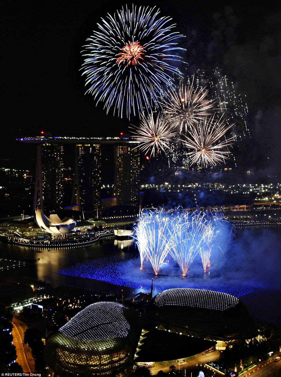Fireworks explode over Marina Bay during the New Year celebrations in Singapore