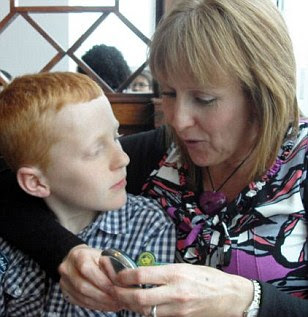 Heartbroken: Simon's mother Julie has paid tribute to her son and says he was mercilessly bullied at school