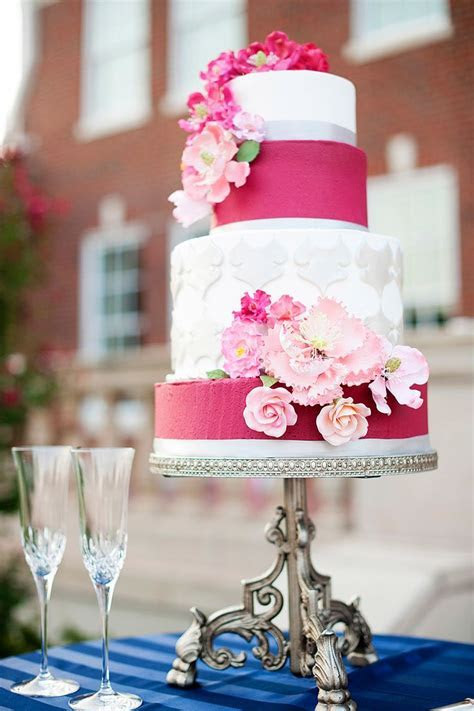 Beautiful four tier white and hot pink wedding cake with