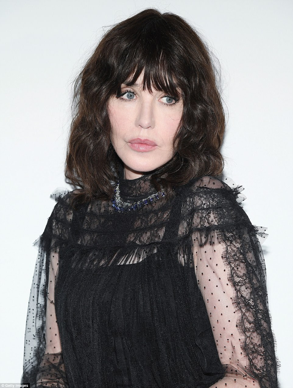 Sheer pleasure! Isabelle Adjani exuded sophistication in her chic blouse which featured lace embellished sheer sleeves