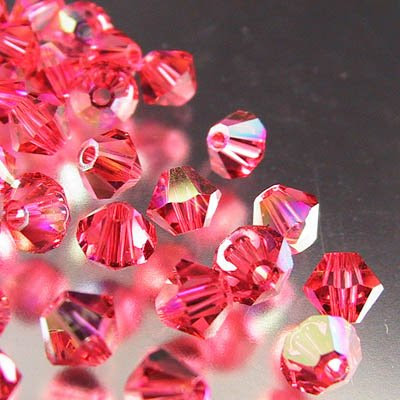 27753011550542 Swarovski Bead - 4 mm Faceted Bicone (5301) - Padparadscha AB (36)
