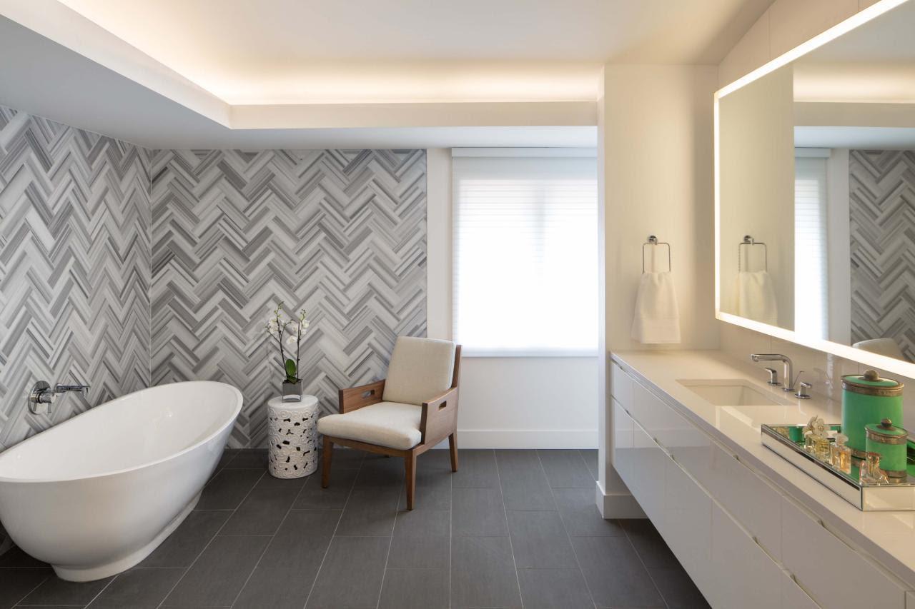 Herringbone Tile Wall Uplifts Modern Master Bathroom | HGTV