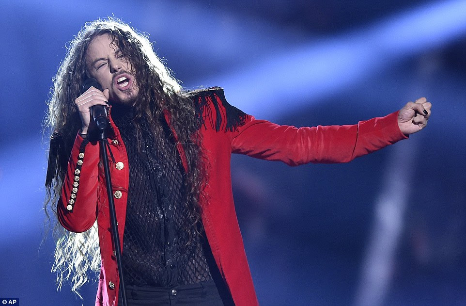 Poland's Michal Szpak performed the song Color Of Your Life and wowed the crowd in a red military inspired blazer
