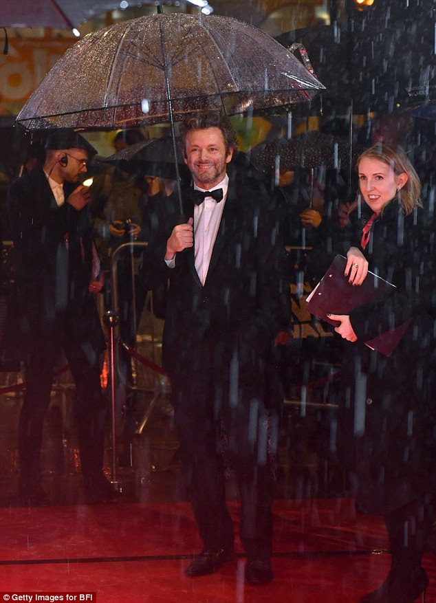 Host with the most: Michael Sheen looked a little bemused by the downpour