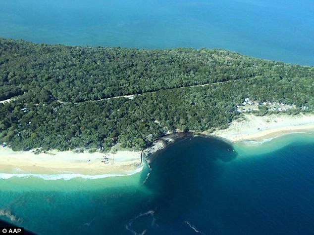 A 100m by 100m sinkhole rapidly opened up at around 11pm on Saturday near Queensland's Rainbow Beach
