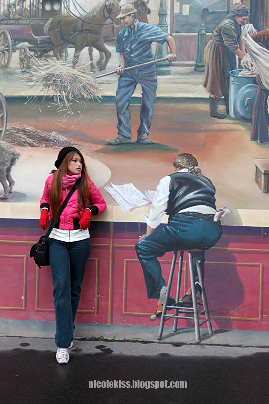 chilling against a mural