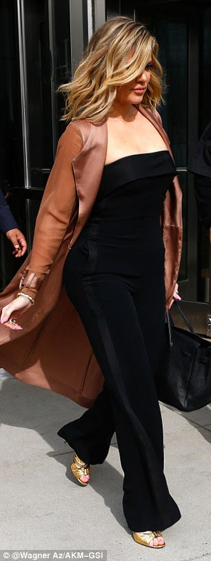 Done and dusted: The daughter of Kris Jenner looked ready for a break when she exited the event