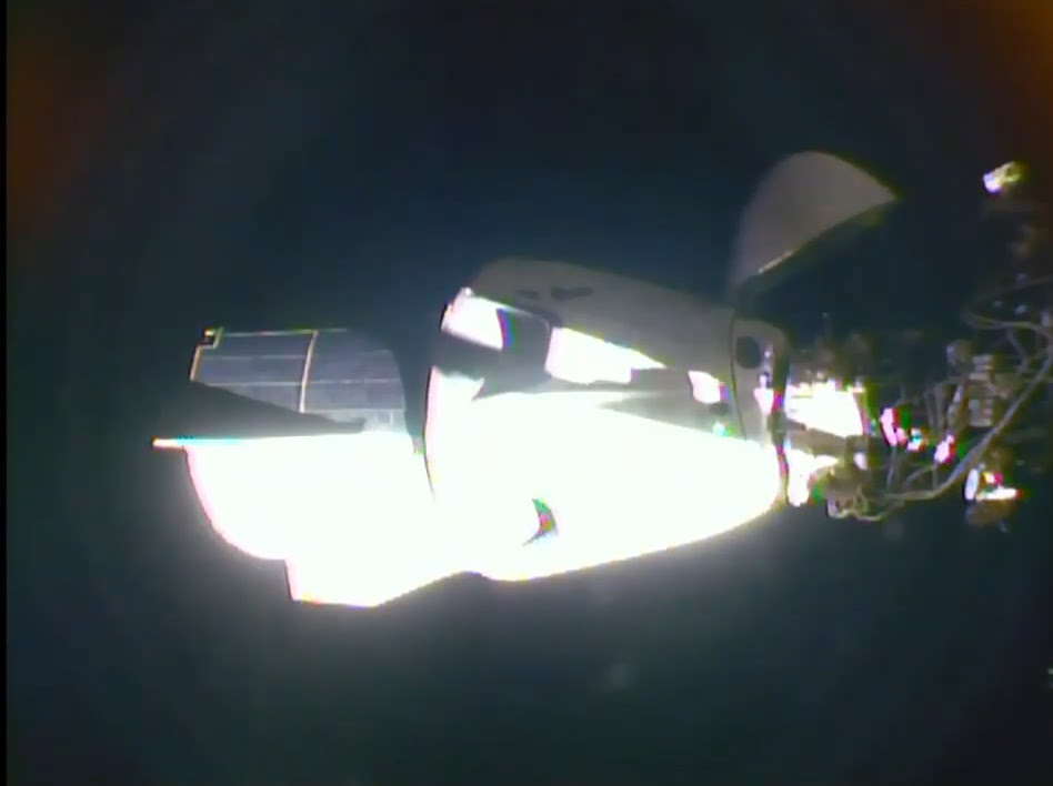 SpaceX's 1st Crew Dragon with astronauts docks at space station in historic rendezvous
