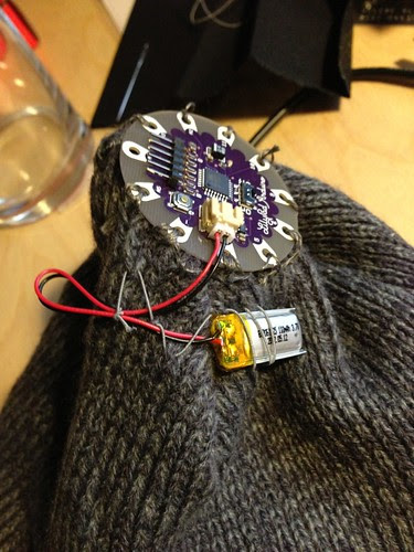 Battery sewed in place on hat