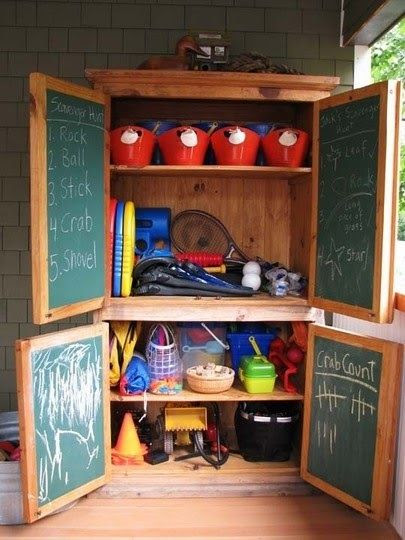 Here is an unexpected outdoor toys' organizer! There is so much you can do with this! In the garage, on a covered patio, back porch--just protecting it with the right paint and clear sealer and it should last well outside.