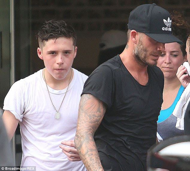 David Beckham and his son Brooklyn both walked away from the accident unscathed. Here the two are pictured leaving a gym in Los Angeles