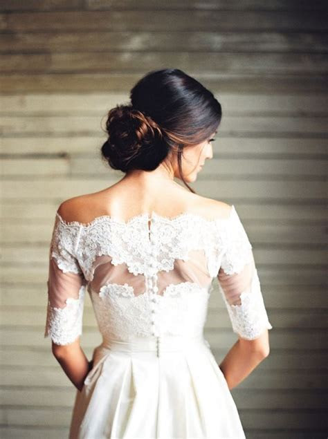 low wedding bown hairstyle and off shoulder wedding dress