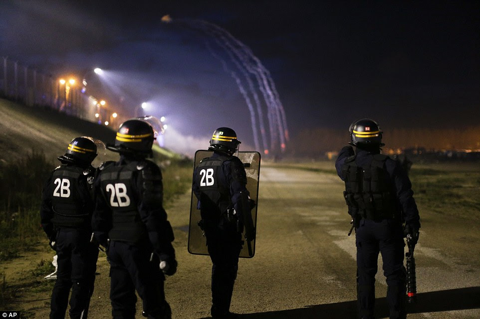 Riot police attended the scene near the 'Jungle' and fired tear gas towards the migrants who were throwing stones