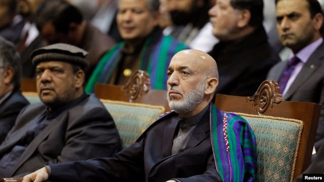 Afghan President Hamid Karzai attends the last day of the Loya Jirga, in Kabul, Nov. 24, 2013.