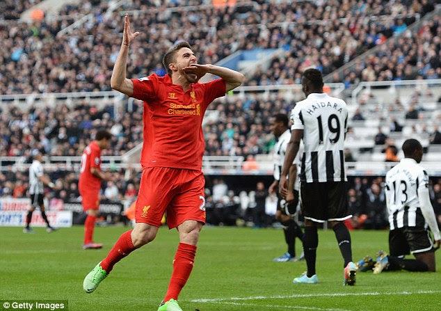 Celebration: Fabio Borini shows his delight after netting Liverpool's fifth goal
