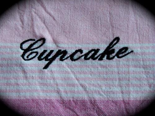 Cook a cupcake. A decorative tea towel.