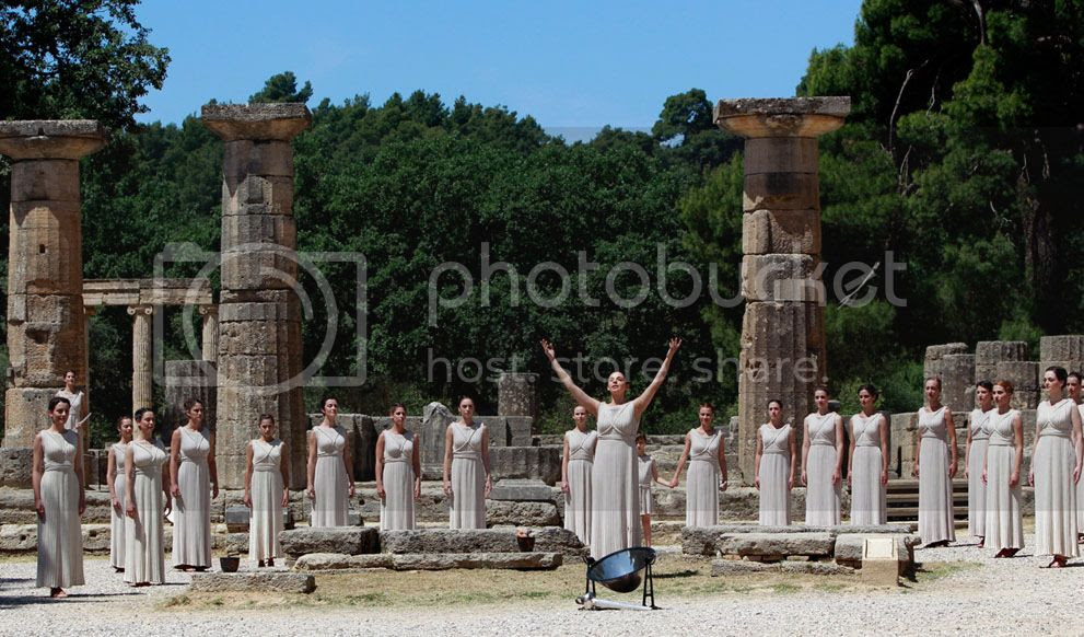 Greek actress Ino Menegaki, playing the role of High Priestess, prepares to light the Olympic Flame in Greece, on May 9, 2012. (Reuters/John Kolesidis)