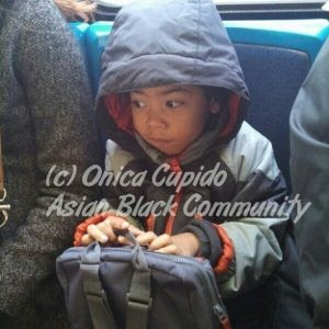 kid thinking on bus