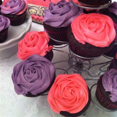 Rose cupcakes using Wilton 2D frosting tip   Wilton 1M