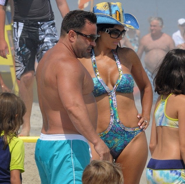 60c5a1d6b9cc Real Housewives' Teresa Giudice puts on a united front with husband on  bikini break after he brands her a 'b***h' and 'c***' in secret phone call  | Of ...