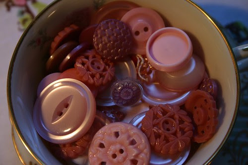 pink buttons in teacup