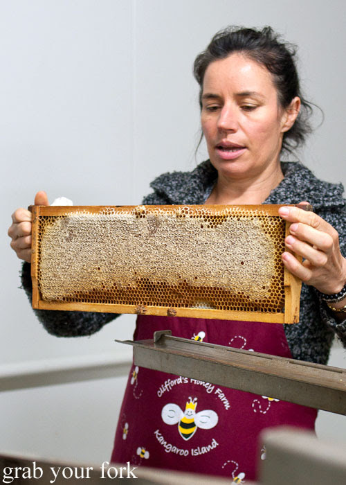 Bev Clifford with a rack of honey at Clifford's Honey Farm, Kangaroo Island
