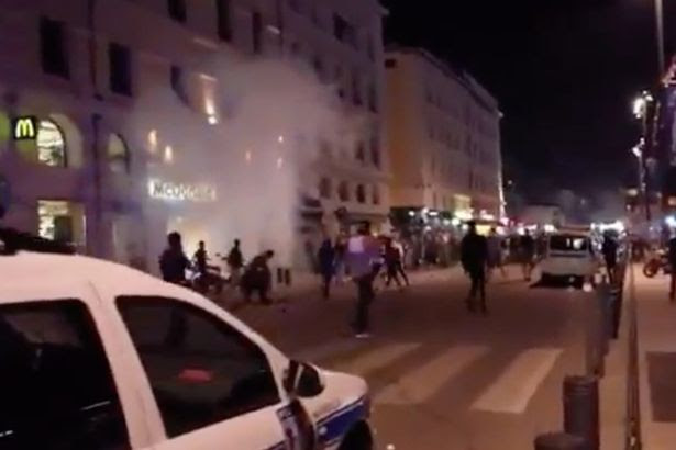 Violence flares between England fans and youths in Marseille
