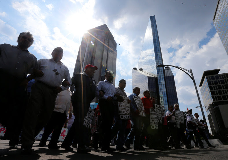 Protesters from the National Coordinator of Education Workers (CNTE) teachers' union march against President Enrique Peña Nieto