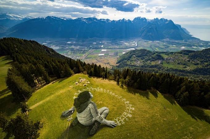 Πέρα από την κρίση: Ο Saype κάνει γκράφιτι στις Άλπεις για τον κορονοϊό